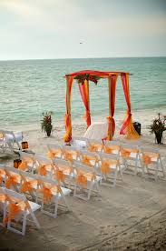 tropical orange red beach wedding and i think it would be
