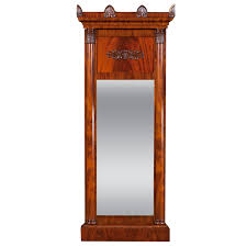 large empire mirror in cuban mahogany with columns and carved