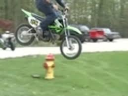 small motocross bikes guy rides small dirt bike off ramp jukin media