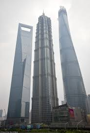 shanghai tower builders celebrate placing the last truss on top of