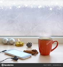 cup of coffee smartphone headphones and tree ornaments