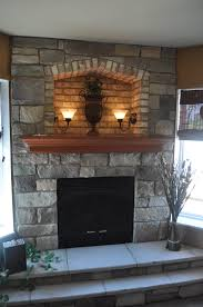 stoned fireplace with cove 2 step hearth and crown maple mantle