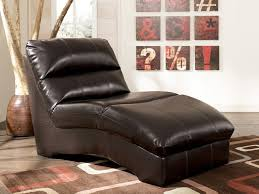 black leather reading chair with back on brown rug of comfort