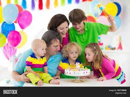 family celebrating birthday image photo bigstock