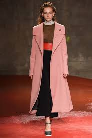 miranda kerr heads out wearing a red skirt and pink coat for paris