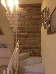 pallet wood wall paneling stairway and living room 101 pallet