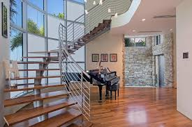 contemporary staircase with high ceiling hardwood floors in