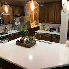 white kitchen cabinets brown countertops calacatta clara quartz kitchen countertops in frisco tx