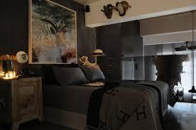 master bedroom for men with dark interior also hardwood bedside