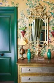 house interior with wallpaper and forest green interior door