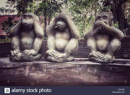 three wise monkey statues stock photo royalty free image