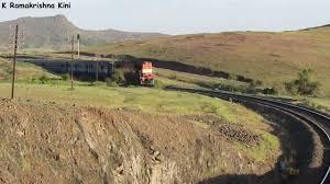 Rugged Landscape Indian Railways Diesel Train In Mountain Rugged Landscape