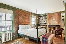 this greenwich village co op with exposed brick and fireplaces