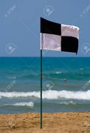 Blue Flag Beach Quartered Black And White Flag On The Beach Showing Zoned Off