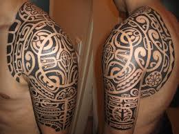 polynesian maori half sleeve and chest plate tattoos photo 1