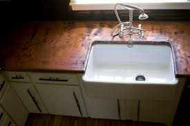 Your Guide To  Popular Kitchen Countertop Materials - Kitchen counter with sink