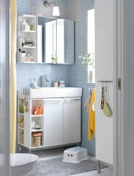 placing modern bathroom wall cabinet beside and inside mirror for