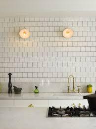 countertops white subway tile backsplash gold finished kitchen