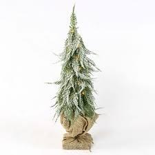 lit battery downswept christmas tree with hessian sack warm white