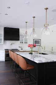 kitchen with black island and white cabinets white kitchens with islands pictures and ideas hunker