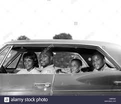 family car side view 1960s side view outdoor smiling african american family father