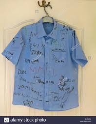 classmates search school leavers shirt with signatures of classmates stock photo
