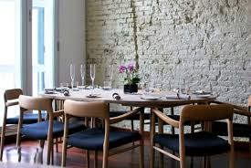 rustic scandinavian dining room design with white brick wall and