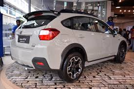 black subaru crosstrek crystal black silica roof spoiler on a khaki xv how might it