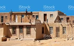 adobe houses acoma pueblo street with old adobe houses sky city stock photo