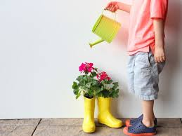 upcycle your kid u0027s old rain boots u0026 turn them into cute planters