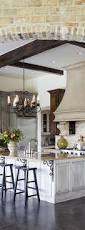 traditional kitchen islands brown storage black barstool stainless stell stove floor