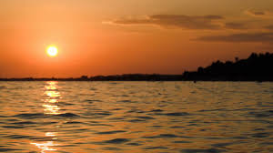 beautiful sunrise or sunset above sea with sun path reflected in
