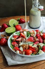 simple strawberry salad with coconut honey lime poppy seed