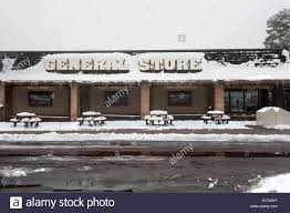 the front of a general merchandise store in the snowy cold
