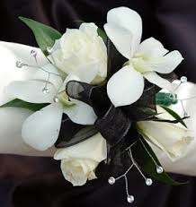 and black corsage white sweetheart and white orchid corsage black