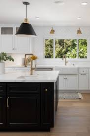 kitchen with black island and white cabinets 50 white herringbone backsplash tile in style white