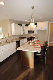 two tones l shaped kitchen layout with island on dark brown wooden