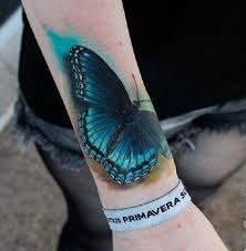 black and blue butterfly on arm sleeve