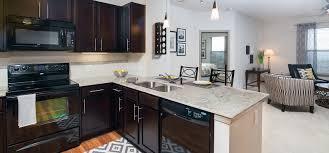 luxury sandy springs apartments windsor at glenridge gourmet kitchens with islands caesarstone countertops and decorative backsplash at windsor at glenridge