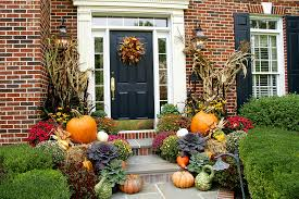 outdoor autumn decorations decorating outside of house for fall home