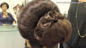 60s beehive hairstyle on short hair back combed big hair style
