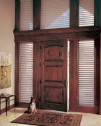 a gorgeous entryway with door shades