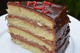 gluten free vanilla cake with chocolate buttercream frosting and