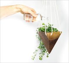 Geometric Hanging Planter by Fernweh Woodworking Creates A Collection Of Hanging Geometric Wood