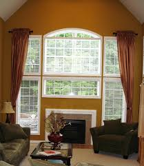 calm in soft green high ceiling window treatments in home office