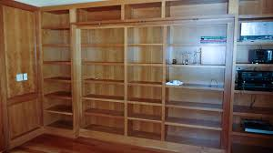 Wooden Bookcase Plans Free by Hidden Pivot Bookcase Installation Thisiscarpentry