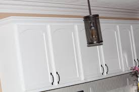 how to paint stained kitchen cabinets white our diy kitchen remodel painting your cabinets white