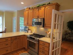 oak kitchen cabinets with black appliances tehranway decoration