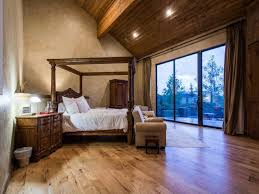 contemporary master bedroom with interior wallpaper hardwood