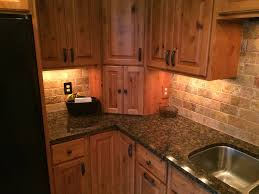 Baltic Brown Granite Countertops With Light Tan Backsplash by Kitchen Backsplash Kitchen Backsplash Countertops Tan Brown